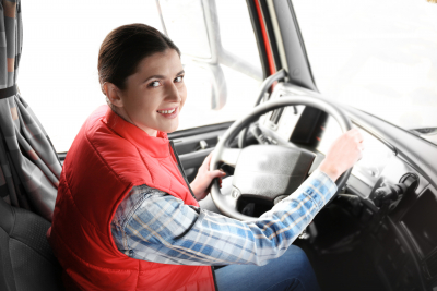 woman in red jacket driving truck